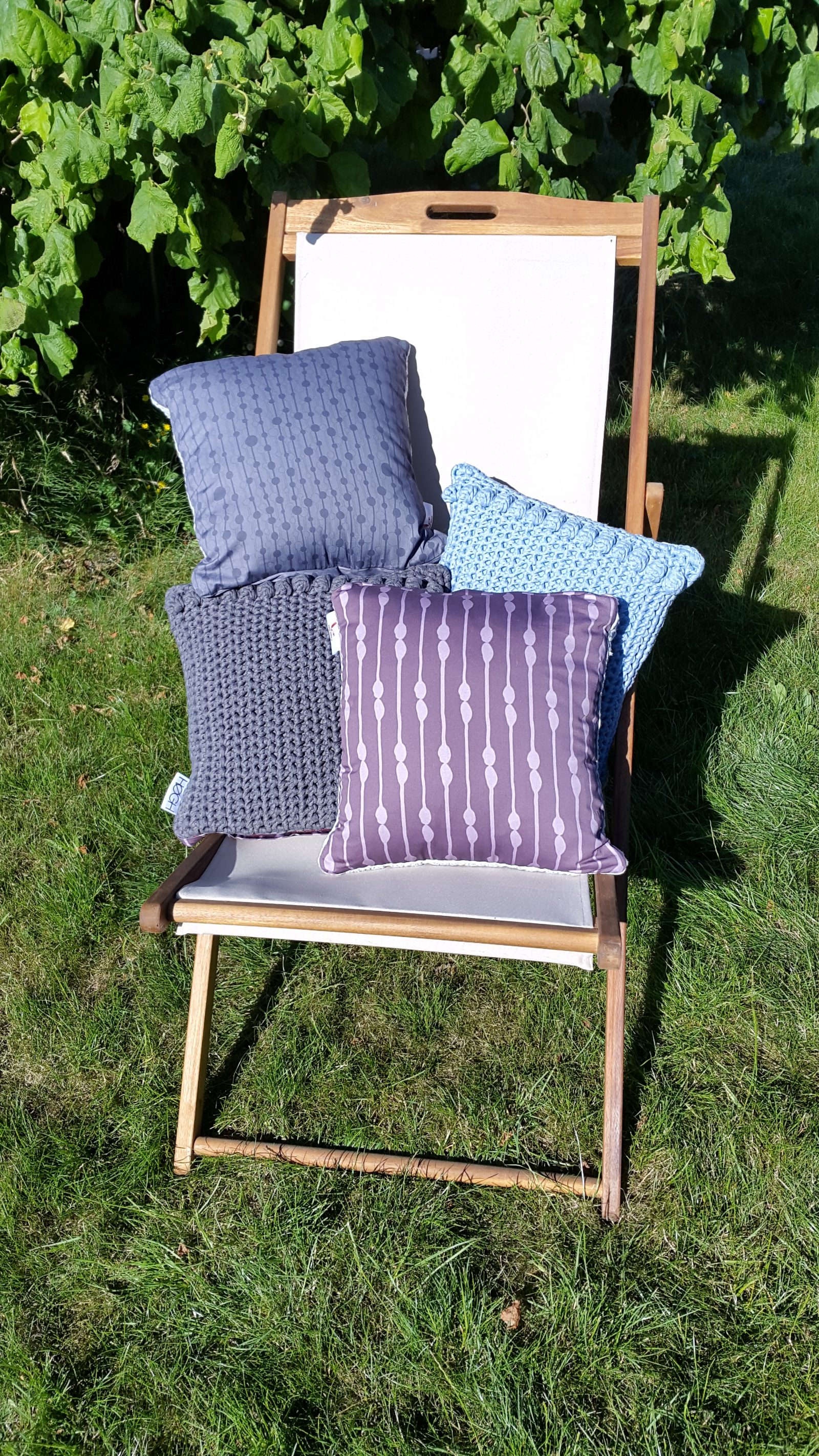 crocheted cushions in deckchair