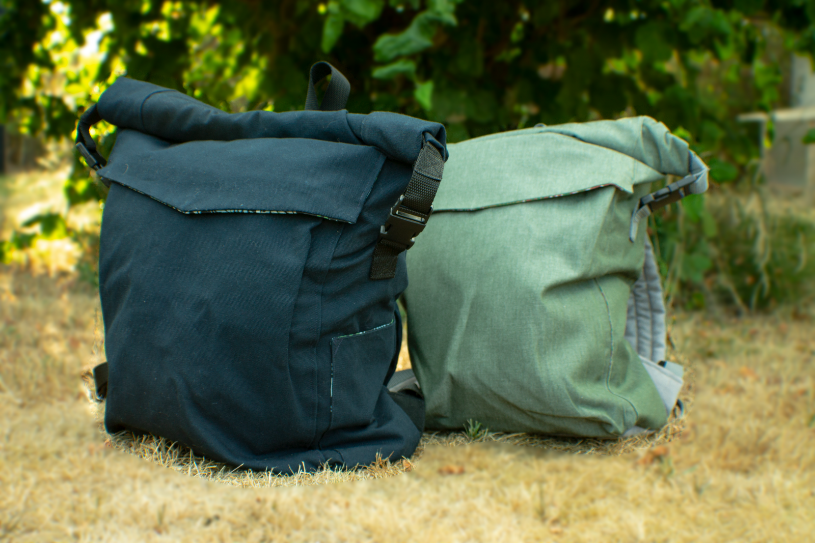 Blue and Green Roll-Top Backpacks