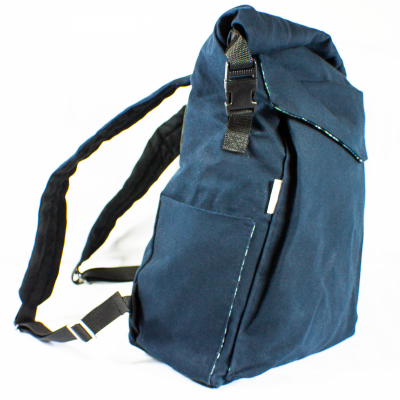 From the side Blue Roll-Top Backpack